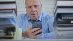 Businessman Job Text Using Mobile Phone in Office Room. Image with a Businessman Job Text Using Mobile Phone in Office Room stock images