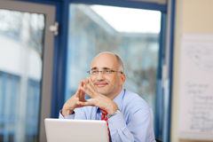 Businessman Joining Fingers While Looking Away Stock Image