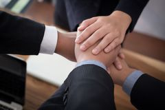 Businessman joining hand, business team touching hands together. Businessman joining united hand, business team touching hands together after complete a deal in Stock Photo