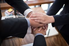 Businessman joining hand, business team touching hands together. Businessman joining united hand, business team touching hands together after complete a deal in Royalty Free Stock Images