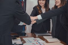 Businessman joining hand, business team touching hands together. Businessman joining united hand, business team touching hands together after complete a deal in Royalty Free Stock Photos