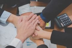 Businessman joining hand, business team touching hands together. Businessman joining united hand, business team touching hands together after complete a deal in Royalty Free Stock Photo