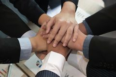 Businessman joining hand, business team touching hands together. Businessman joining united hand, business team touching hands together after complete a deal in Stock Image