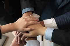Businessman joining hand, business team touching hands together. Businessman joining united hand, business team touching hands together after complete a deal in Royalty Free Stock Image