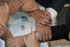 Businessman joining hand, business team touching hands together. Businessman joining united hand, business team holding hands together in circle loop. unity Stock Images