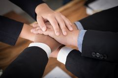 Businessman joining hand, business team touching hands together. Businessman joining united hand, business team touching hands together after complete a deal in Royalty Free Stock Photography