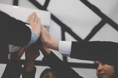 Businessman joining hand, business team touching hands together. Businessman joining united hand, business team touching hands together after complete a deal in Stock Photos