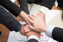 Businessman joining hand, business team touching hands together. Businessman joining united hand, business team touching hands together after complete a deal in Stock Photography