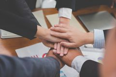 Businessman joining hand, business team touching hands together. Businessman joining united hand, business team touching hands together after complete a deal in Stock Images