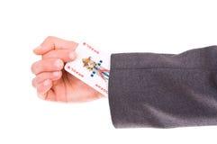 Businessman with Joker card hidden under sleeve. Business man with Joker card hidden under sleeve Royalty Free Stock Photos