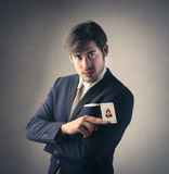 A businessman with a joker in his hands Royalty Free Stock Images