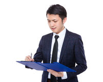 Businessman jot note on clipboard Royalty Free Stock Photo