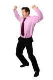 Businessman jubilation. Young businessman in gesture of jubilation, both arms up in the air celebrating, isolated stock photography