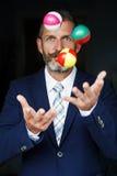 Businessman juggles balls Stock Photos