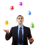 Businessman juggling Royalty Free Stock Image