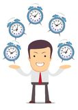 Businessman juggling with alarm clocks Royalty Free Stock Photo