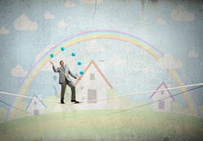 Businessman juggling with balls Royalty Free Stock Photography