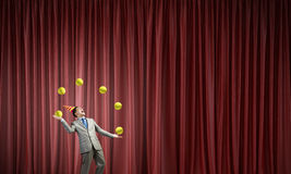 Businessman juggling with balls Royalty Free Stock Photos