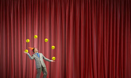 Businessman juggling with balls Stock Photo