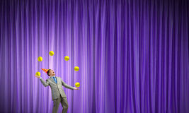 Businessman juggling with balls Stock Image