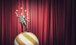 Businessman juggling with balls Stock Photos