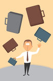Businessman juggling with briefcases Royalty Free Stock Image
