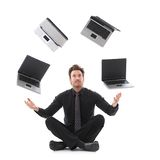 Businessman juggling with laptops Royalty Free Stock Images