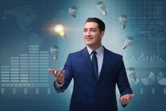 The businessman juggling lightbulbs in new idea concept Royalty Free Stock Photography