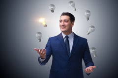 The businessman juggling lightbulbs in new idea concept Stock Photos