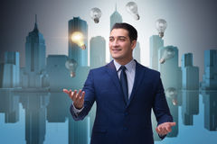 The businessman juggling lightbulbs in new idea concept Royalty Free Stock Images