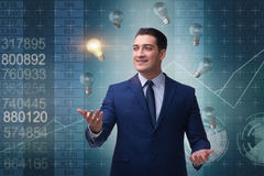 The businessman juggling lightbulbs in new idea concept Stock Photography