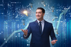 The businessman juggling lightbulbs in new idea concept Royalty Free Stock Image