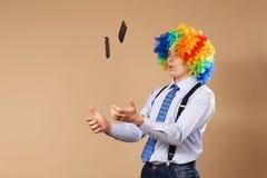 Businessman juggling mobile phones Stock Photos