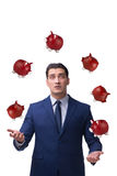 The businessman juggling with piggybanks in business concept. Businessman juggling with piggybanks in business concept Stock Photography