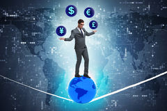 The businessman juggling between various currencies Stock Photography