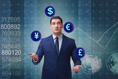 The businessman juggling between various currencies Royalty Free Stock Photos