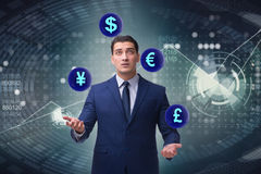 The businessman juggling between various currencies Stock Photos