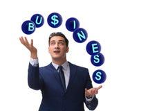 The businessman juggling between various priorities in business Stock Photos