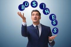 The businessman juggling between various priorities in business Royalty Free Stock Images