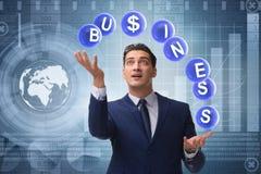 The businessman juggling between various priorities in business Royalty Free Stock Photos