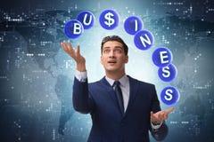 The businessman juggling between various priorities in business Royalty Free Stock Image