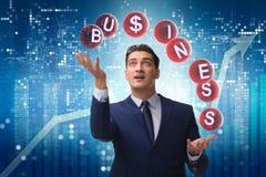 The businessman juggling between various priorities in business Stock Photo