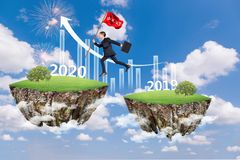 Free Businessman Jump Between 2019 And 2020 Years Stock Photos - 166137473