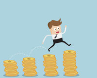 Businessman Jump On Coins Stack Royalty Free Stock Photos