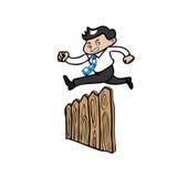 Businessman jump over fence Stock Photo
