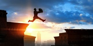 Free Businessman Jump Over Leap. Mixed Media Stock Photo - 156146720