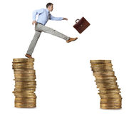 Businessman jump for risk Stock Image