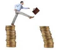 Businessman jump for risk Stock Image