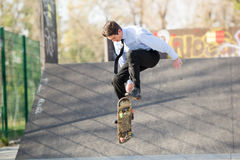 Businessman In The Jump With Skateboard Stock Photography