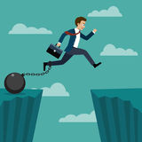 Businessman jumped over a cliff. Stock Photo